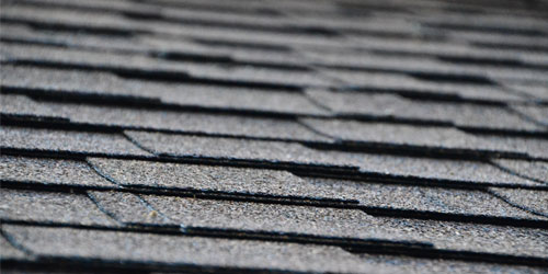 Close up of asphalt shingles on a home