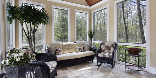 Sunroom filled with floor to ceiling windows and french doors